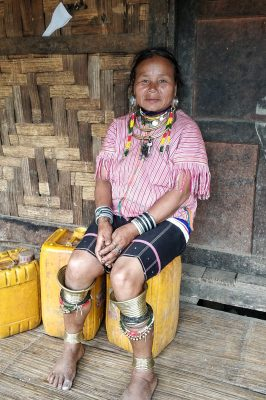 Burmese Woman With Traditional Golden Rings Around Her Knees
