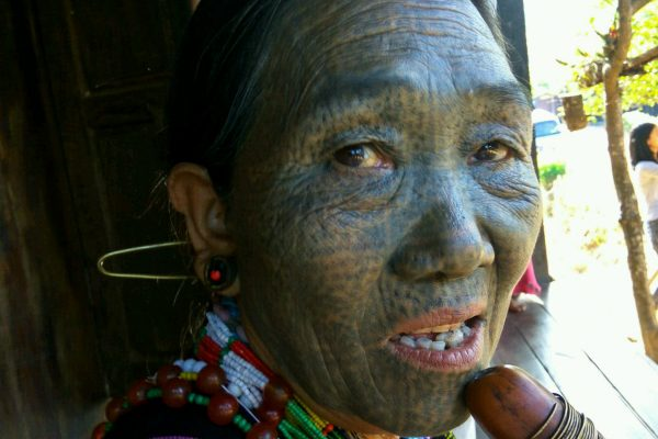 Tattooed Woman With Traditional Pipe