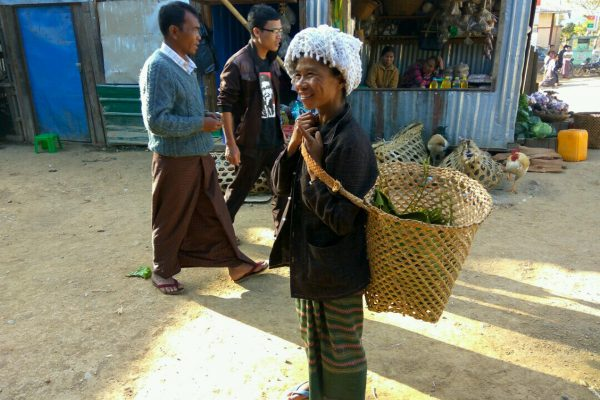 Smiling Burmese Woman With Basket
