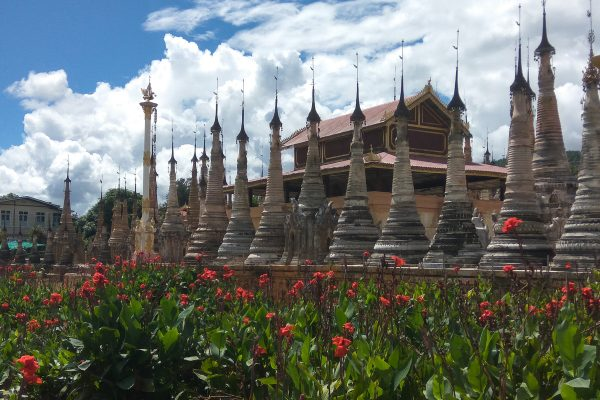 Pagoda With Red Flowers Beside Inle Lake