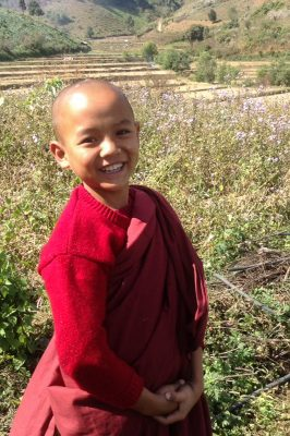 A Young Buddhist Novice Is Smiling