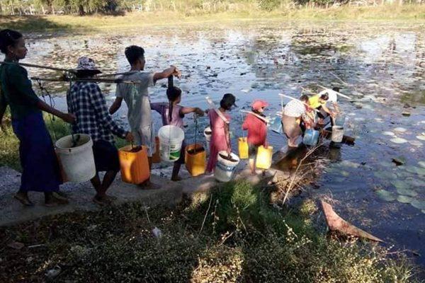 Burmese People At The Yangon River